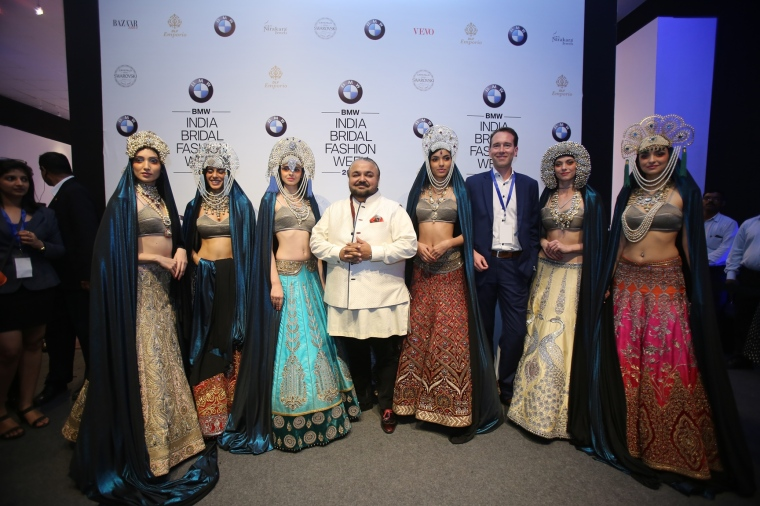 L to R - JJ Valaya with models, Mr. Frank Schloeder, Director Marketing, BMW Group India
